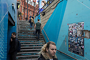 Londoners use the underpass steps leading into the Old Street station in Shoreditch, on 4th November 2019, in London, England.