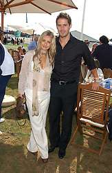 JAMIE & LOUISE REDNAPP at the 2005 Cartier International Polo between England & Australia held at Guards Polo Club, Smith's Lawn, Windsor Great Park, Berkshire on 24th July 2005.<br />