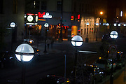 LED streetlights made by Relume Technologies, Inc., illuminate the intersection of S. Main and W. Washington in Ann Arbor, MI, Thursday, May 7, 2009. Ann Arbor has installed LED streetlights to reduce lighting costs and greenhouse gas emissions. ..