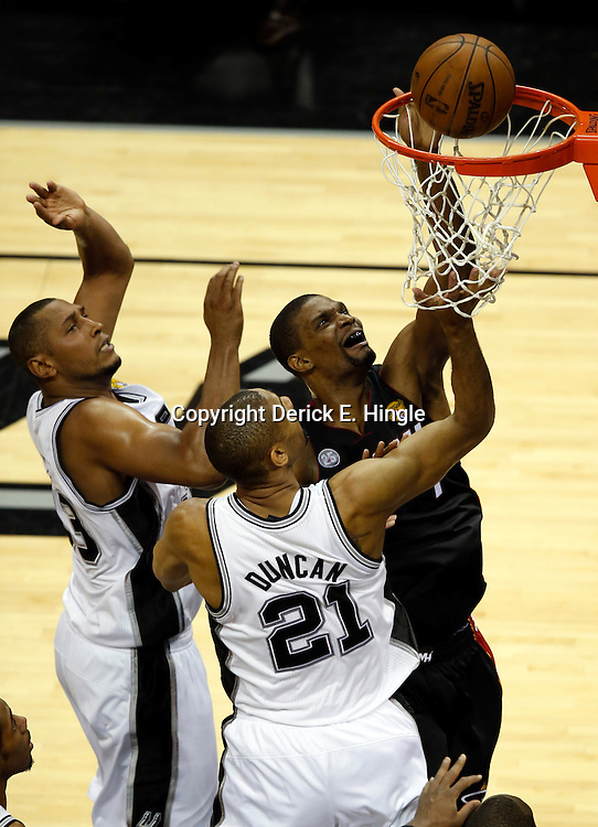 Jun 16, 2013; San Antonio, TX, USA; Miami Heat center Chris Bosh (1) shoots against San Antonio Spurs power forward Tim Duncan (21) during the second quarter of game five in the 2013 NBA Finals at the AT&T Center. Mandatory Credit: Derick E. Hingle-USA TODAY Sports