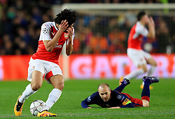 Arsenal's Mohamed Elneny reacts after fouling Andres Iniesta of Barcelona  - Mandatory byline: Matt McNulty/JMP - 16/03/2016 - FOOTBALL - Nou Camp - Barcelona,  - FC Barcelona v Arsenal - Champions League - Round of 16