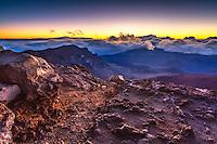 Sunrise from the summit of Haleakala Volcano on the island of Maui in Haleakala National Park.