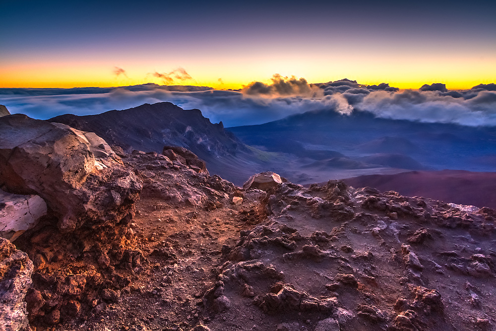 Sunrise from the summit of Haleakala Volcano on the island of Maui in Haleakala National Park.