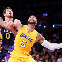 19 October 2014: Los Angeles Lakers forward Carlos Boozer (5) vies for the rebound with Utah Jazz center Enes Kanter (0) during the Los Angeles Lakers 98-91 victory over the Utah Jazz, in a preseason game, at the Staples Center, Los Angeles, California, USA.