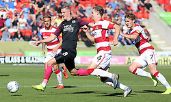 Josh Knight of Peterborough United is closed down by Doncaster Rovers players - Mandatory by-line: Joe Dent/JMP - 21/09/2019 - FOOTBALL - The Keepmoat Stadium - Doncaster, England - Doncaster Rovers v Peterborough United - Sky Bet League One