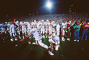 John Hopkins of Stanford warms up before kicking the game winning field goal in the 93rd Big Game between Cal and Stanford played on November 17, 1990 at Memorial Stadium in Berkeley, California.  Visible players include Paul Stonehouse #11, Chris Dalman #50, Toby Norwood #52, and Mark Hanson #92,    Stanford won by a final score of 27-25.  Photograph © 1990 David Madison.