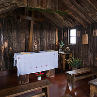 Interior of the tiny, wooden Stella Maris Chapel at Cape Horn in Chile. Cape Horn (Cabo de Hornos) is the southernmost headland of the Tierra del Fuego archipelago and it marks the northern boundary of the Drake Passage and where the Atlantic and Pacific Oceans meet.