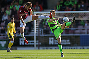 Northampton Towns Andy Williams(9) tackles Forest Green Rovers Nathan McGinley(19) during the EFL Sky Bet League 2 match between Northampton Town and Forest Green Rovers at Sixfields Stadium, Northampton, England on 13 October 2018.
