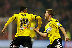 *CAPTION CORRECTION* Andre Gray of Brentford (L) celebrates with Alan Judge after scoring a goal to make it 0-2 - Photo mandatory by-line: Rogan Thomson/JMP - 07966 386802 - 05/11/2014 - SPORT - FOOTBALL - Nottingham, England - City Ground - Nottingham Forest v Brentford - Sky Bet Championship.
