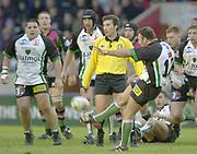 Photo. Peter Spurrier.Parker Pen Challenge Cup 17/01/2004 Harlequins v Montauban.Montauban defender kicks clear. as referee  A Lombardi looks on...   [Mandatory Credit, Peter Spurier/ Intersport Images].