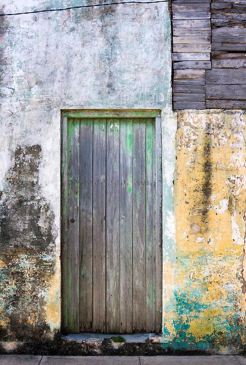 Weathered wall and door in Cardenas, Matanzas, Cuba.