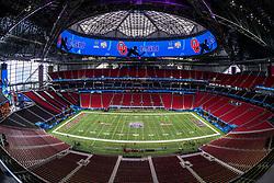 A general view of the interior of Mercedes Benz Stadium and fans during the 2019 College Football Playoff Semifinal at the Chick-fil-A Peach Bowl, between the Oklahoma Sooners and LSU Tigers, Saturday, December 28, 2019, in Atlanta. LSU defeated Oklahoma 63-28. (Paul Abell via Abell Images for the Chick-fil-A Peach Bowl)