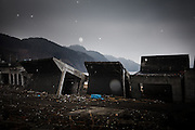 Toni, February 24 2012 - A destructed anti-tsunami retaining wall lies in the harbour of Toni, Iwate prefecture.