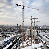 Nederland, Amsterdam ,14 januari 2010..<br /> Op het Oosterdokseiland wordt het hoofdkantoor van Vodafone  wereldwijd de grootste mobiele telecomaanbieder gebouwd.<br /> At Oosterdokseiland in Amsterdam, the headquarters of Vodafone is being built,  the world's largest mobile telecom operator .