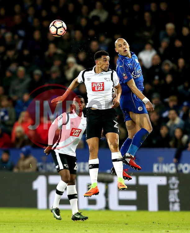 Yohan Benalouane of Leicester City and Nick Blackman of Derby County challenge for a header - Mandatory by-line: Robbie Stephenson/JMP - 08/02/2017 - FOOTBALL - King Power Stadium - Leicester, England - Leicester City v Derby County - Emirates FA Cup fourth round replay