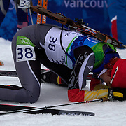 Winter Olympics, Vancouver, 2010.Kati Wilhelm, Germany,  feels the pain after finishing during the Women's 7.5 KM Sprint Biathlon at The Whistler Olympic Park, Whistler, during the Vancouver  Winter Olympics. 13th February 2010. Photo Tim Clayton
