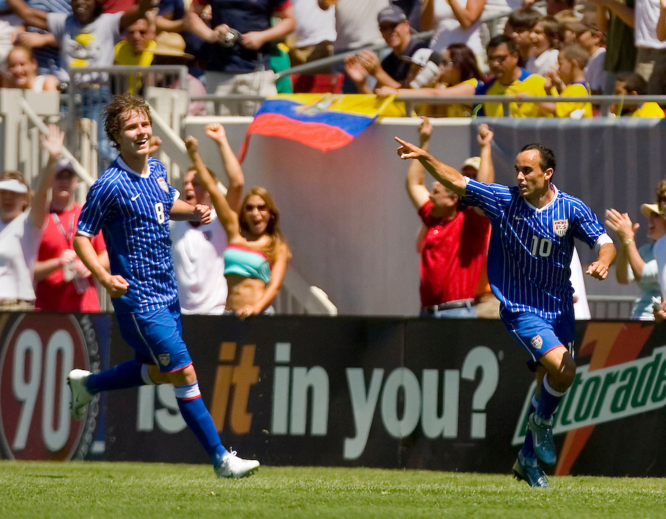 United States' Landon Donovan (R) runs down the sidelines celebrating his third goal with teammate Michael Bradley during the second half of their international friendly soccer match against Ecuador in Tampa, Florida March 25, 2007. REUTERS/Scott Audette (UNITED STATES)