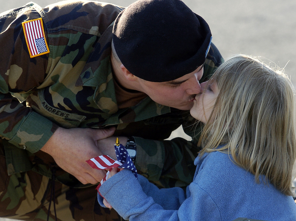 SPC. Matthew Andrews, of Salem Virginia, kisses his six year old daughter Karli while saying good-bye at the New Cumberland U.S. Army Reserve Center, Tuesday November 9, 2004.  Andrews is one of fourty-two Army Reserve soldiers of the 453rd Finance Battalion (Detachments 1 and 2), of New Cumberland, PA., who are leaving for an 18 month tour of duty in Iraq. The 453rd Finance Battalion has the mission of paying soldiers and vendors, providing currency for military businesses, exchanging foreign currencies, answering pay inquiries for soldiers and providing banking support as needed..Leaving the New Cumberland U.S. Army Reserve Center, the soldiers will travel to Fort McCoy in Wisconsin for six weeks of additional training before heading to Iraq. John Pavoncello photo