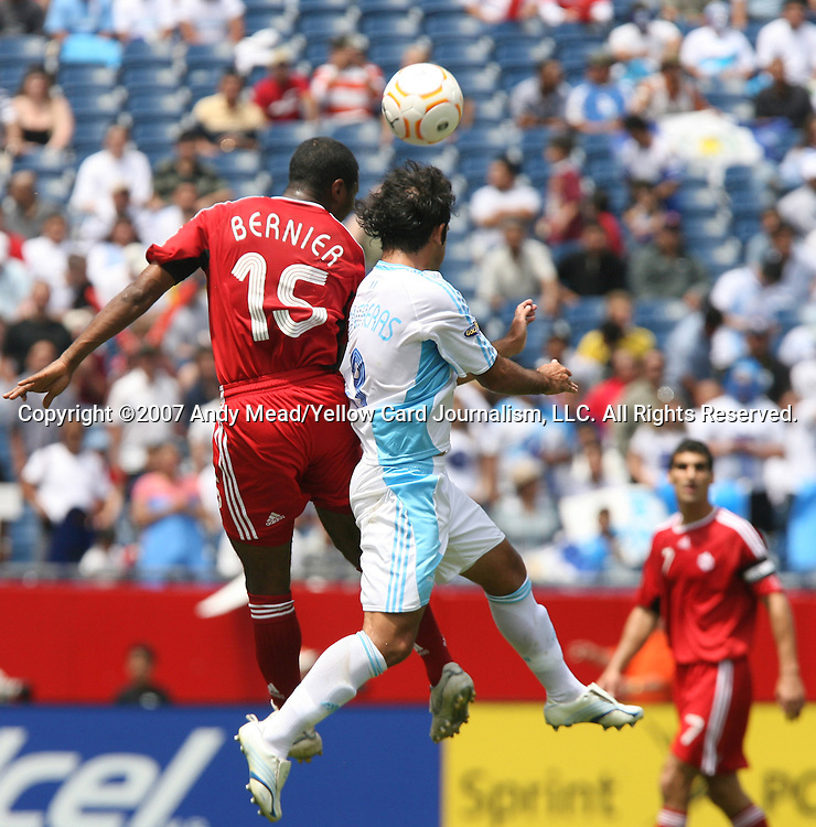 16 June 2007: Canada's Patrice Bernier (15) and Guatemala's Jose Contreras (r) challenge for a header. The Canada Men's National team defeated the Guatemala Men's National Team 3-0 at Gillette Stadium in Foxboro, Massachusetts in a 2007 CONCACAF Gold Cup quarterfinal.