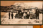"""Trapper George Johnston bought his dream car in 1928, a four cylinder Model AB Chevrolet sedan, shipped by steamer from Whitehorse several hundred miles via the Yukon and Teslin Rivers to Teslin village. The local Taylor & Drury store fueled it with naphtha. At first, his only road was 78 miles of frozen Taslin Lake. For his taxi service in Teslin, George Johnston built a 3- to 5-mile road, which later became part of the Alaska Highway. The car is now displayed in the George Johnston Museum, Alaska Highway, Teslin, Yukon, Canada. The Alaska Highway was built as a military road during World War II in just 9 months in 1942, to link existing airfields via Canada to the territory of Alaska. The ALCAN Highway (a military acronym for Alaska-Canada) opened to the public in 1948. It begins in Dawson Creek, British Columbia, and runs via Whitehorse, Yukon to Delta Junction, Alaska. The """"Alaskan Highway"""" is comprised of British Columbia Highway 97, Yukon Highway 1 and Alaska Route 2. While the ALCAN measured 2700 kilometers (1700 mi) upon completion in 1942, by 2012 it was rerouted and shortened to 2232 km (1387 mi). Once legendary for being a rough, challenging drive, the highway is now paved over its entire length. Delta Junction, at the end of the highway, claims """"Historic Milepost 1422"""" where the Alaska Highway meets the Richardson Highway, which continues 96 mi (155 km) to the city of Fairbanks at Historic Milepost 1520, often (but unofficially) regarded as the northern portion of the Alaska Highway (although its Mileposts are measured from Valdez)."""