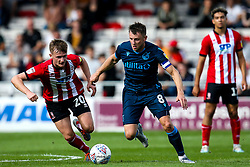Ollie Clarke of Bristol Rovers goes past Callum Connolly of Lincoln City - Mandatory by-line: Robbie Stephenson/JMP - 14/09/2019 - FOOTBALL - Sincil Bank Stadium - Lincoln, England - Lincoln City v Bristol Rovers - Sky Bet League One