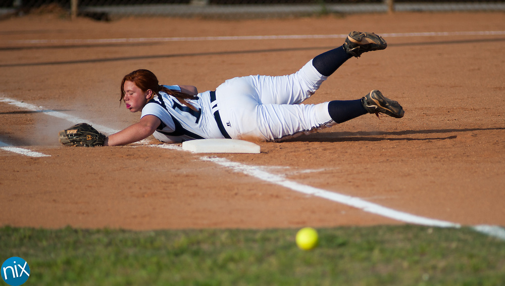 Hickory Ridge's Jessica Hagler dives and misses a foul ball hit down the line by Concord in South Piedmont Conference softball action Tuesday afternoon in Harrisburg. Hickory Ridge won the game 7-1.  (Photo by James Nix)
