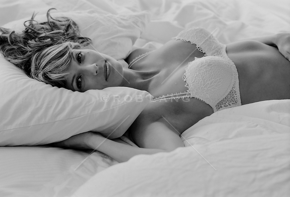 beautiful woman in bed wearing a lace bra