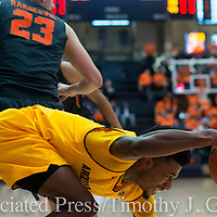 Arizona State's Shannon Evans II front, is tripped by Oregon State's Gligorije Rakocevic (23) during the first half of an NCAA college basketball game in Corvallis, Ore., Thursday, Feb. 2, 2017. (AP Photo/Timothy J. Gonzalez)