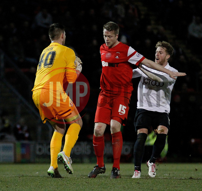 Nathan Clarke Leyton Orient's defender shields Alex Cisak Leyton Orient's goalkeeper from Billy Clarke Bradford City's forward as he makes a save - Photo mandatory by-line: Mitchell Gunn/JMP - Mobile: 07966 386802 - 18/02/2015 - SPORT - Football - London - Brisbane Road - Leyton Orient v Bradford City - Sky Bet League One