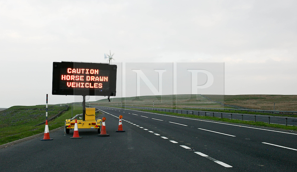 © Licensed to London News Pictures. 06/06/2013<br /> <br /> Appleby, Cumbria, United Kingdom.<br /> <br /> Signs along the A66 warn travellers about the annual gathering of gypsies and travellers takes place on 6 June, 2013 in Appleby, Cumbria. The event remains one of the largest and oldest events in Europe and gives the opportunity for travelling communities to meet friends, celebrate their music, their folklore and to buy and sell horses.<br /> <br /> The five day event has existed under the protection of a charter granted by King James II in 1685 and it remains the most important event in the gypsy and traveller calendar.<br /> <br /> Photo credit : Ian Forsyth/LNP