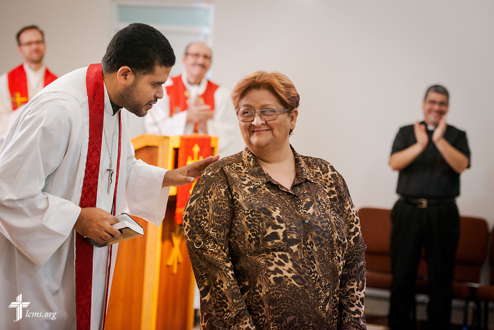 Sylvia Gonzalez is acknowledged warmly by parishioners and visiting pastors after she was confirmed by the Rev. Gustavo Maita, pastor of Iglesia Luterana Principe de Paz (Prince of Peace Lutheran Church), Mayagüez, Puerto Rico, during worship on Sunday, April 15, 2018. LCMS Communications/Erik M. Lunsford