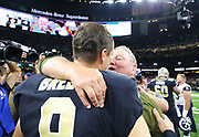 Nov 4, 2018; New Orleans, LA, USA: Los Angeles Rams defensive line coach Bill Johnson and New Orleans Saints quarterback Drew Brees meet after the game at the Mercedes-Benz Superdome. The Saints beat the Rams 45-35. (Steve Jacobson/Image of Sport)