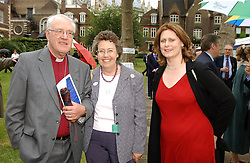 Left to right, LORD & LADY CARREY, he was the former Archbishop of Canterbury and MRS GORDON BROWN  at the annual House of Lords v House of Commons tug of war match in aid of  of  Macmillan Cancer Relief on 22nd June 2004.  A drinks reception was held in College Gardens followd by the tug of war on Victoria Tower Gardens, London.