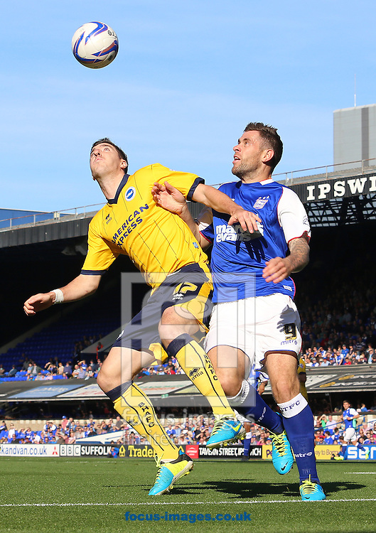 Picture by Richard Calver/Focus Images Ltd +447792 981244<br /> 28/09/2013<br /> Daryl Murphy of Ipswich Town and Stephen Ward of Brighton and Hove Albion fight for the ball during the Sky Bet Championship match at Portman Road, Ipswich.