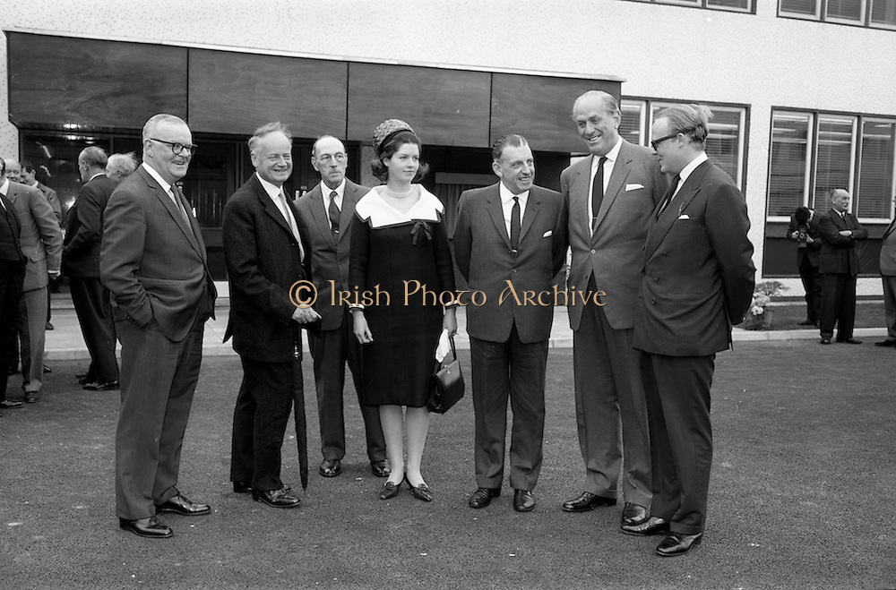 2/7/164<br /> 7/2/1964<br /> 2 July 1964<br /> <br /> An unnamed man with C.K. Mill Director, Lord Boyd Director, Lady Elvedeen, An Taoiseach Mr. Sean Lemanss, Dr. A.K. Mills Chief Chemist, and Lord Elveden speaking outside the lab