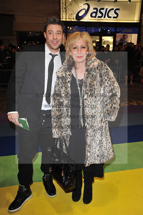 DUNCAN JAMES and his mother FIONA arrive at the press night of the new Andrew Lloyd Webber  musical 'The Wizard of Oz' at The London Palladium, Argylle Street, London on 1st March 2011 followed by an aftershow party at One Marylebone, London NW1