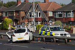 © Licensed to London News Pictures . 22/06/2014 . Manchester , UK . NUMBER PLATE WARNING: POLICE ADVISE RELATIVES OF DECEASED AND SERIOUSLY INJURED WHO WERE IN CORSA ARE YET TO BE INFORMED . Fatal RTA scene in Manchester where a man has died in a three vehicle collision on the East Lancs Road (A580) this afternoon (Sunday 22nd June 2014) . An Audi RS3 and an Audi S3 were travelling eastbound along the A580 when they collided with a Vauxhall Corsa , near to the Swinton Park area . The male driver of the Corsa suffered multiple injuries and was pronounced dead at the scene . A woman passenger also suffered serious injuries and has been taken to hospital in a critical condition . The drivers of the Audis - two men - are under arrest on suspicion of causing death by dangerous driving and are in police custody . Photo credit : Joel Goodman/LNP