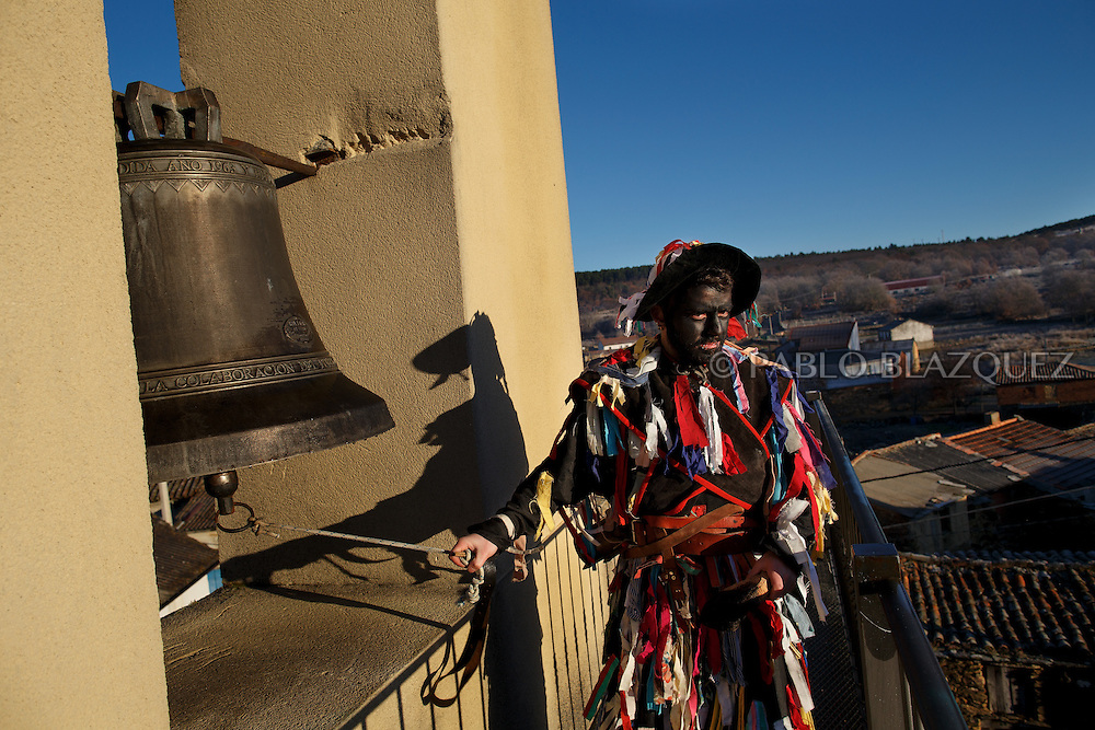 A man dressed as La Filandorra ring the bell of the Church during La Filandorra festival on December 26, 2016 in the small village Ferreras de Arriba, Zamora province, Spain.  La Filandorra festival is a pagan winter masquerade that takes place during Saint Esteban festivities. The parade is represented by four characters, La Filandorra, El Diablo (Devil), La Madama (madame) y El Galán (Gallant). (© Pablo Blazquez)