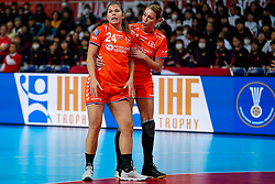 03-12-2019 JAP: Netherlands - Cuba, Kumamoto<br /> Third match 24th IHF Women's Handball World Championship, Netherlands win the third match against Cuba with 51- 23. / Lois Abbingh # 8 of Netherlands and Martine Smeets # 24 of Netherlands are injured by a hard action by goalkeeper Indiana Cedeno Ramos # 12 of Cuba at the World Cup handball in Aqua Dome in Kumamoto.