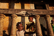 Children living in Roça Ribeira Funda are standing around at sunset, on the island of Sao Tome, Sao Tome and Principe, (STP) a former Portuguese colony in the Gulf of Guinea, West Africa.