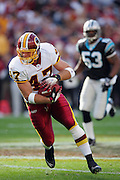 LANDOVER, MD - NOVEMBER 26:  Tight end Chris Cooley #47 of the Washington Redskins gains some yardage after a catch against the Carolina Panthers at FedExField on November 26, 2006 in Landover, Maryland. The Redskins defeated the Panthers 17-13. ©Paul Anthony Spinelli *** Local Caption *** Chris Cooley