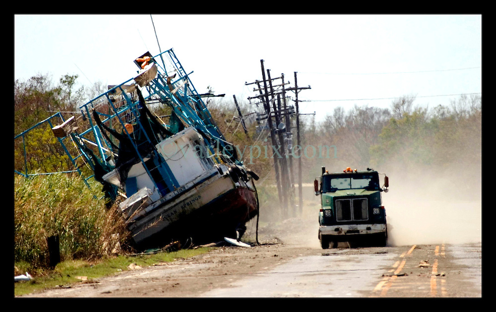 8th Sept, 2005. Hurricane Katrina aftermath. New Orleans. A shrimp boat in East New Orleans, where the tidal surge washed over the land and devastated homes and property dumping ships on the Chef Menteur highway.