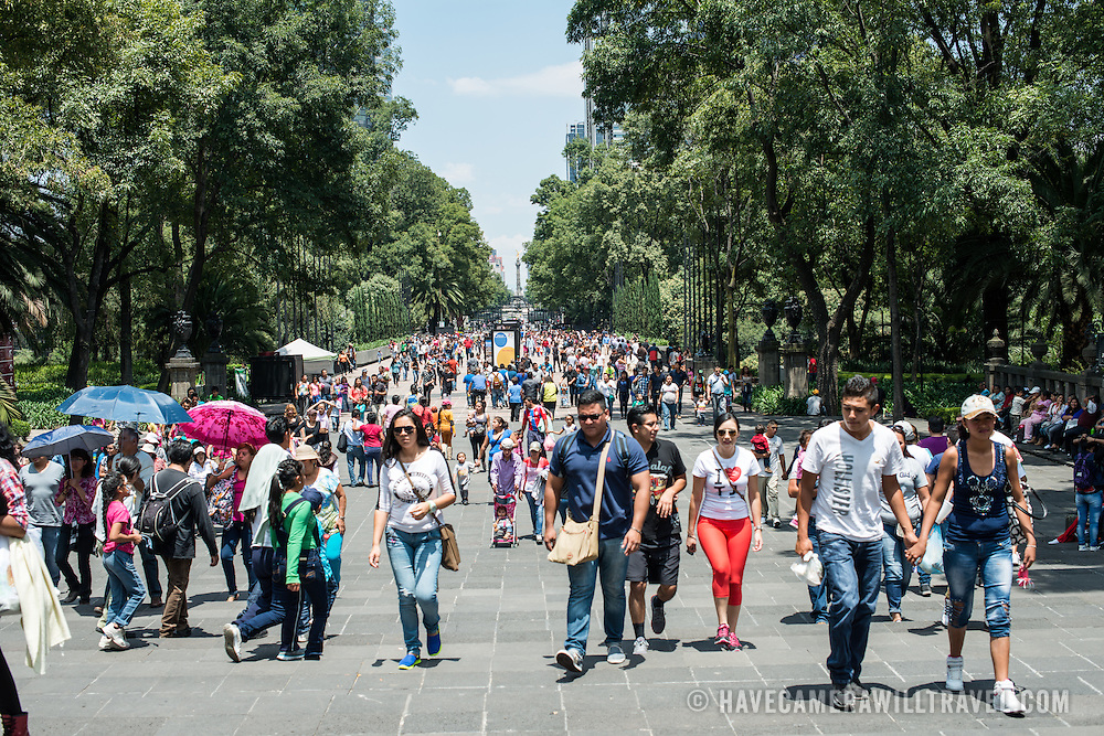 A wide pedestrian boulevard leading into Basque de Chapultepec, a large and popular public park in the center of Mexico City.