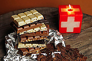 Swiss chocolate to create a tower stacked with swiss candles.