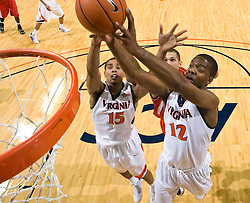 Virginia forward Jamil Tucker (12) and Virginia guard Sylven Landesberg (15) grab a rebound against VMI.  The Virginia Cavaliers defeated the Virginia Military Institute Keydets 107-97 in NCAA Basketball at the John Paul Jones Arena on the Grounds of the University of Virginia in Charlottesville, VA on November 16, 2008.