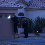 Mesa police officers search the home of a woman who left her children at a hospital. The CPS after--hours unit received a call that the children were ill and the mother failed to get them medical attention. The mother fled after an ambulance took the children to the hospital.