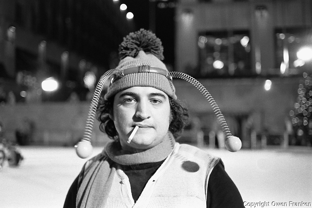 1975, Manhattan, New York, New York, USA --- Comedian John Belushi, in a bumble bee costume, skates at the Rockefeller Center Ice Rink for a skit on Saturday Night Live. --- Image by © Owen Franken/CORBIS