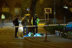 © Licensed to London News Pictures. 24/12/2018. Bromley, UK.Forensic officers on scene, Christmas eve stabbing in Bromley,South East London tonight, victim is said to be in a serious condition. Police cordons in place at the scene. Photo credit: Grant Falvey/LNP