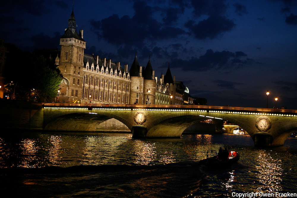 boats on the River Seine, Paris, approaching the Napoleon Bridge, with the conciergerie on Ile de la Cite on the left.