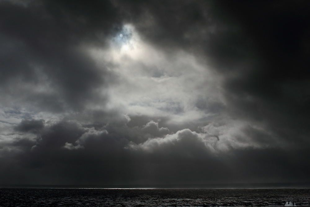 A patch of light between heavy clouds over the southern coast of the Snaefellsnes Peninsular in Western Iceland